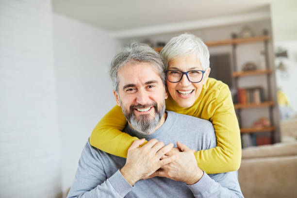 senior couple happy elderly love together man woman portrait gray hair portrait of happy smiling senior couple at home husband stock pictures, royalty-free photos & images