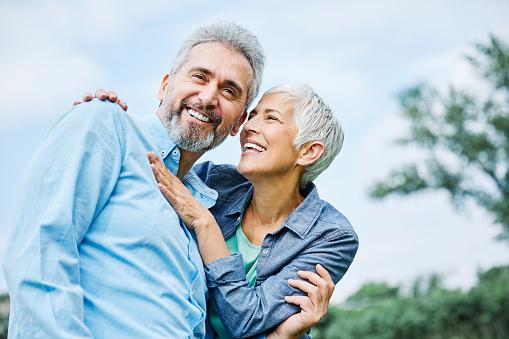 portrait of happy smiling senior couple outdoors
