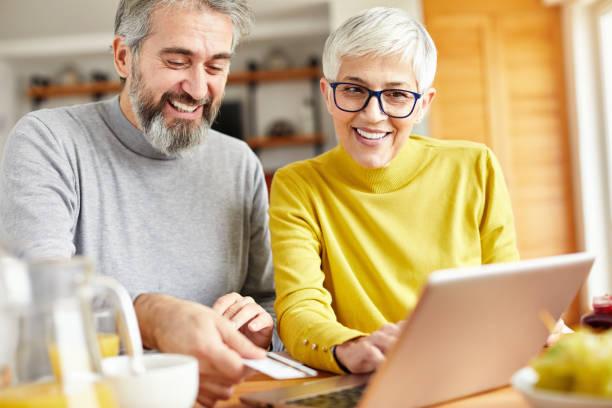 Senior couple happy laptop online shopping debit credit card order picture id1205713420?b=1&k=6&m=1205713420&s=612x612&w=0&h=yyo 94uzqjbomic5504j2suyrqc6x lvhkkzy674e k=