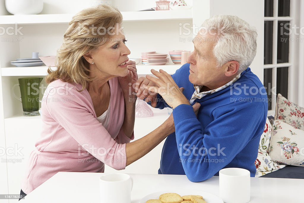 A senior couple having a argument at home stock photo