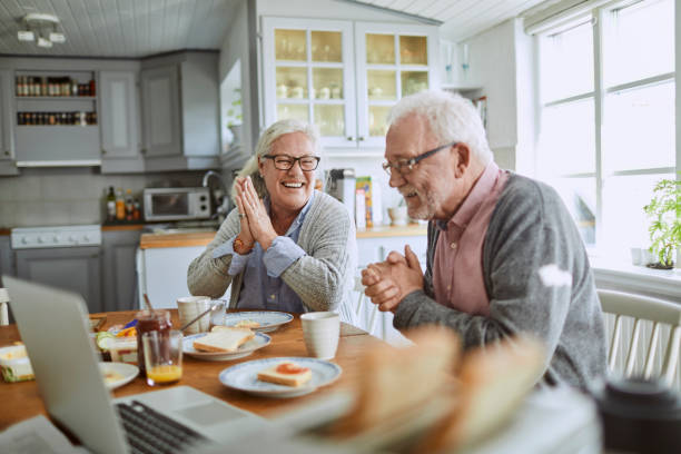 Senior couple having breakfast stock photo