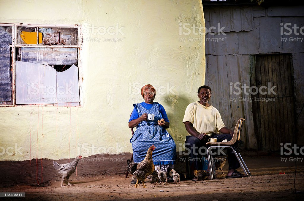 Senior couple having coffee and rusks infront of shelter royalty-free stock photo