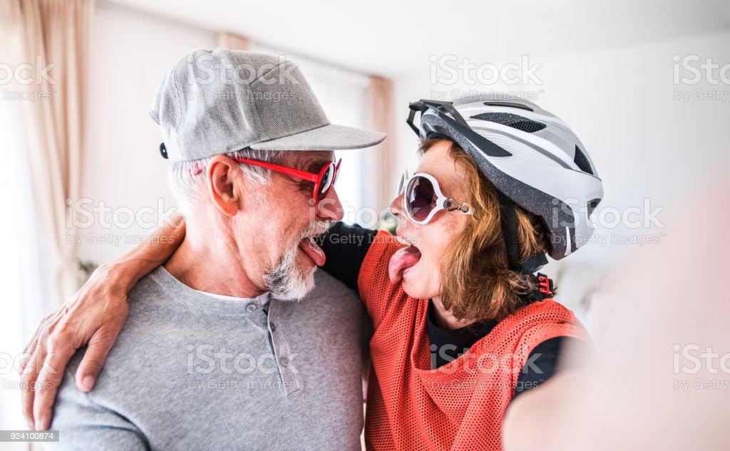 Senior couple having fun at home. stock photo