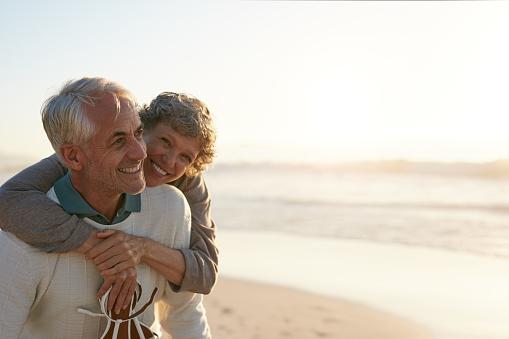 istock Senior couple having fun at the beach 629225096