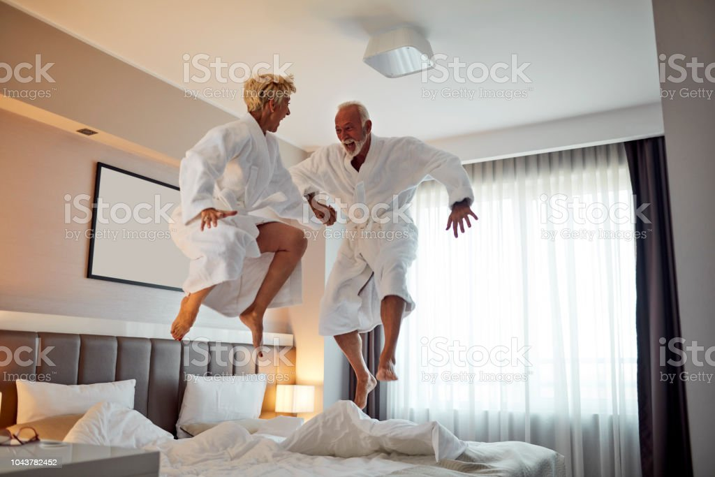 Senior Couple Having Fun in Hotel Room stock photo