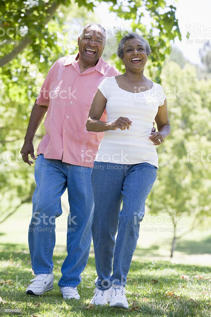 Senior couple having fun in park stock photo