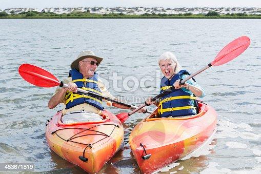 istock Senior couple having fun kayaking together 483671819