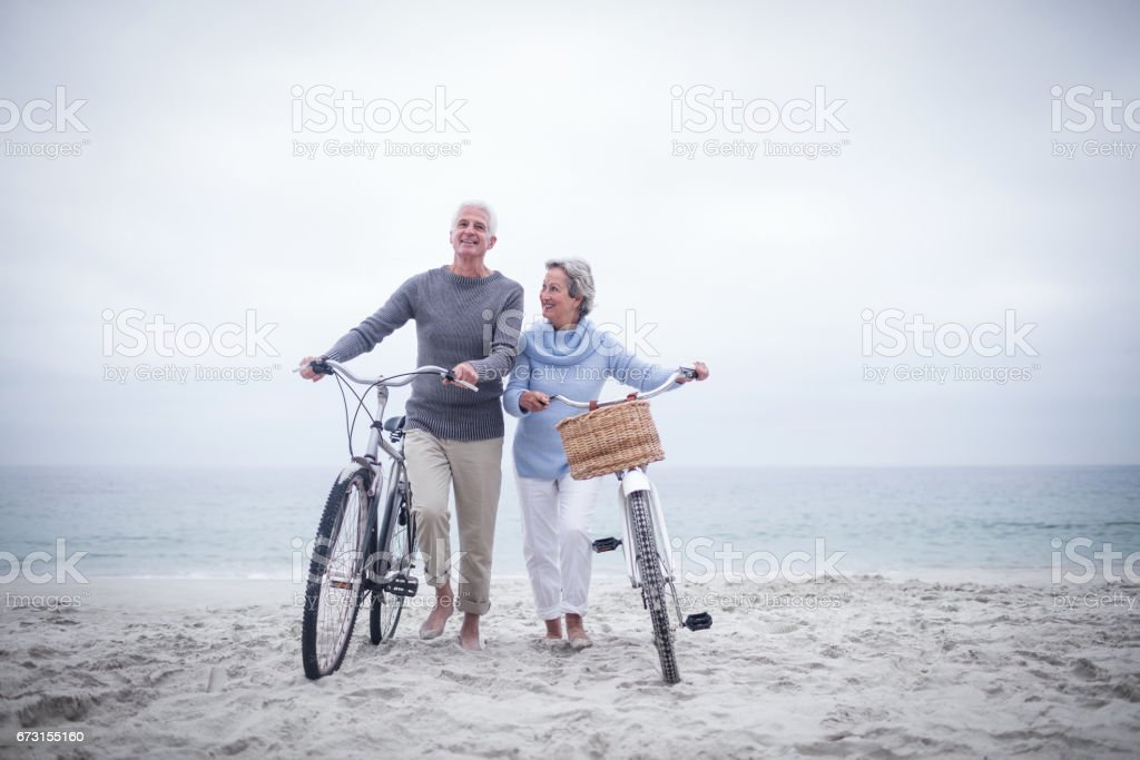 Senior couple having ride with their bike stock photo