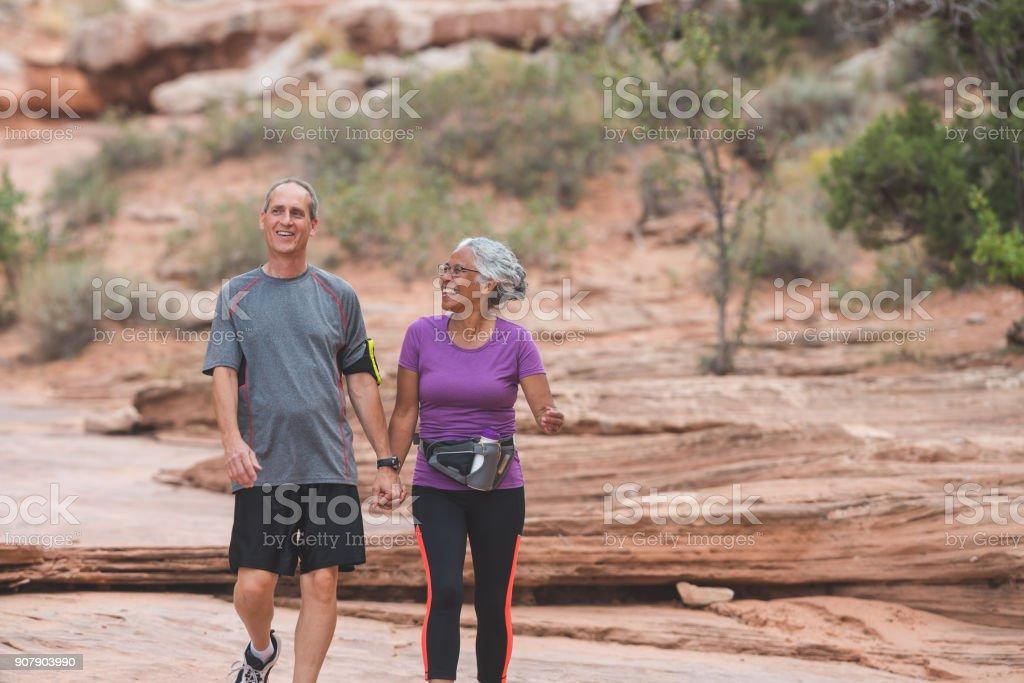 Senior Couple Hiking in Desert stock photo