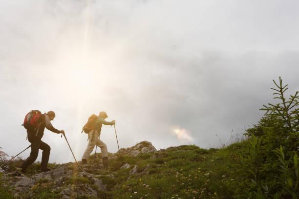 Senior couple hiking in the mountains stock photo