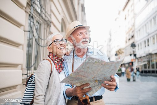 Senior people on vacation, looking for direction