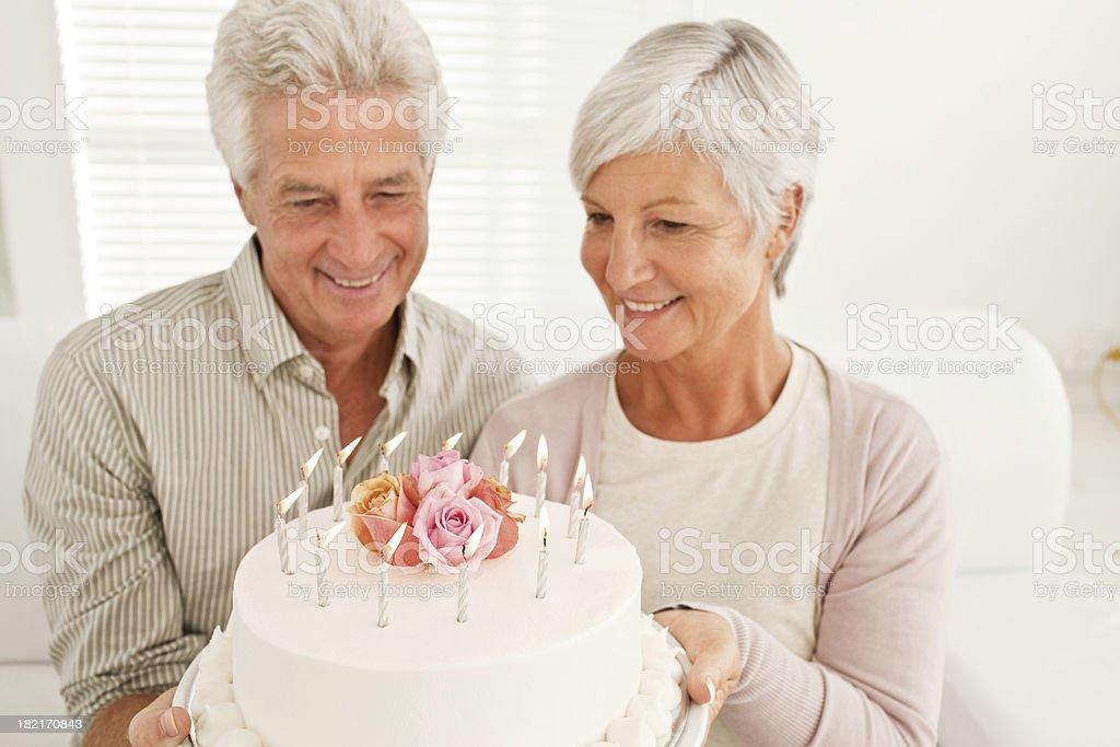 Senior couple holding cake royalty-free stock photo