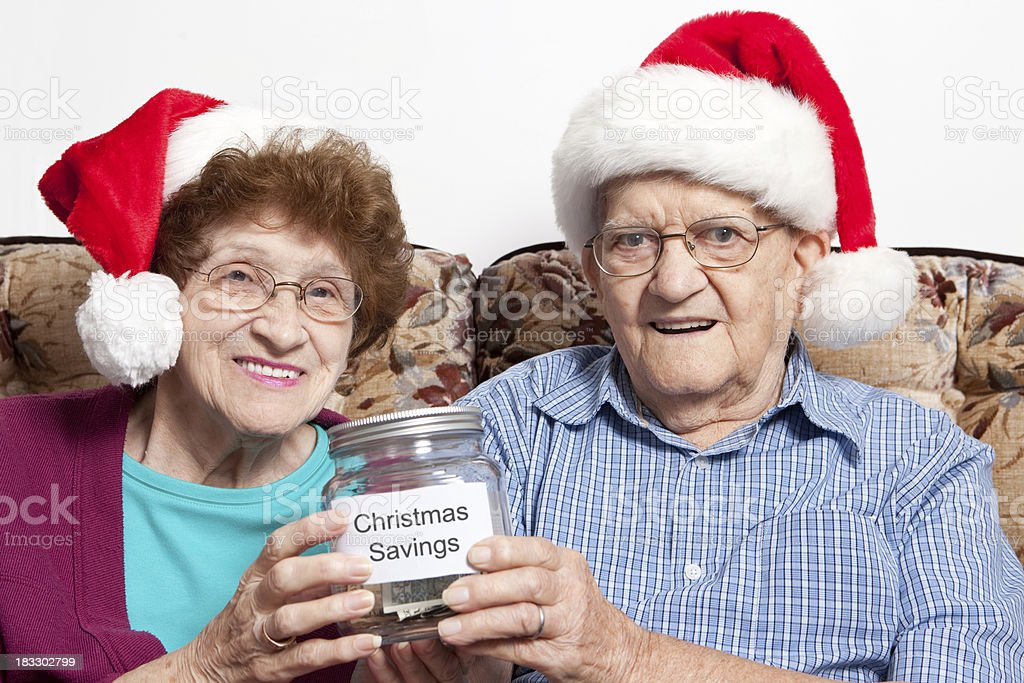 Senior Couple Holding Christmas Savings royalty-free stock photo