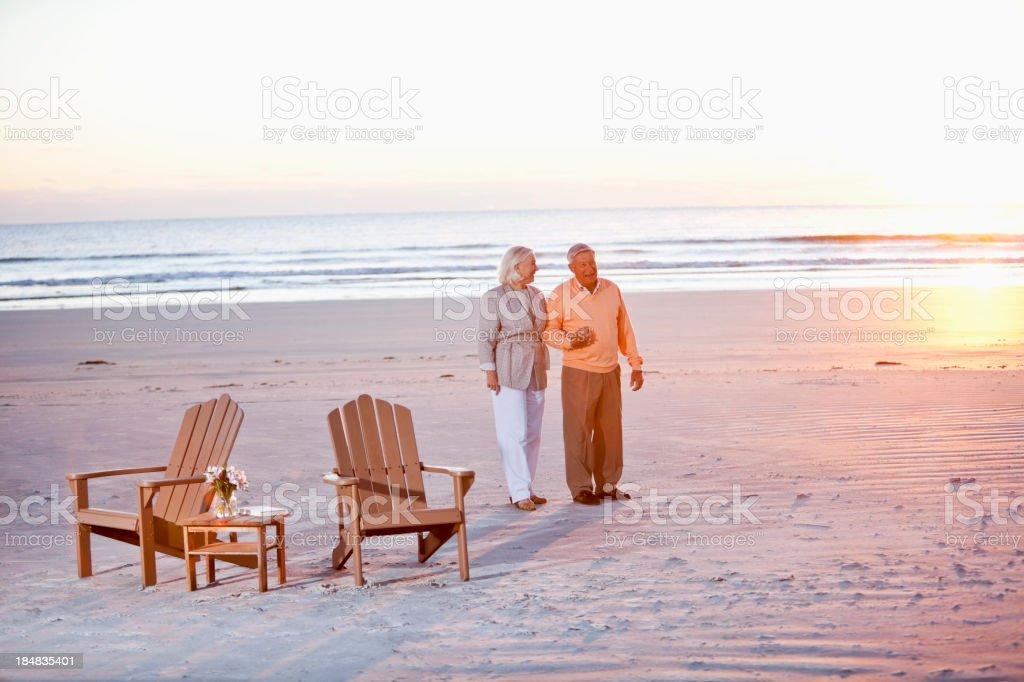 Senior couple holding hands on beach royalty-free stock photo