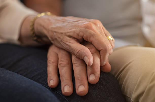 Senior couple holding hands  – Foto