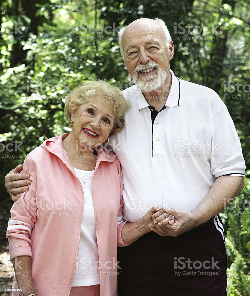 Senior Couple Holding Hands royalty-free stock photo
