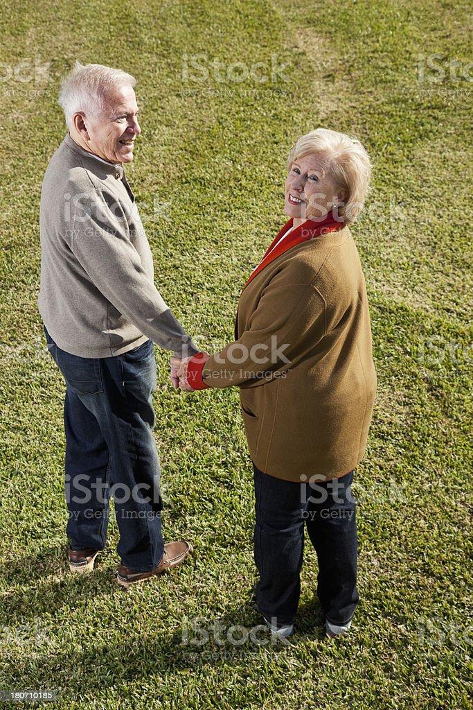 Senior couple holding hands royalty-free stock photo