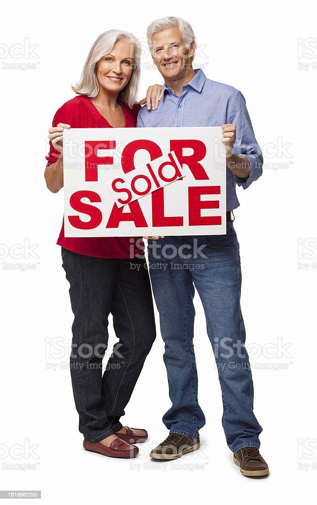 Senior Couple Holding Sign Board - Isolated royalty-free stock photo