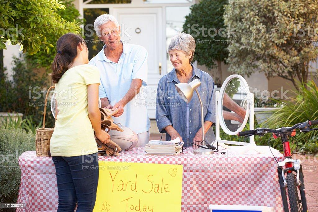 Senior Couple Holding Yard Sale royalty-free stock photo