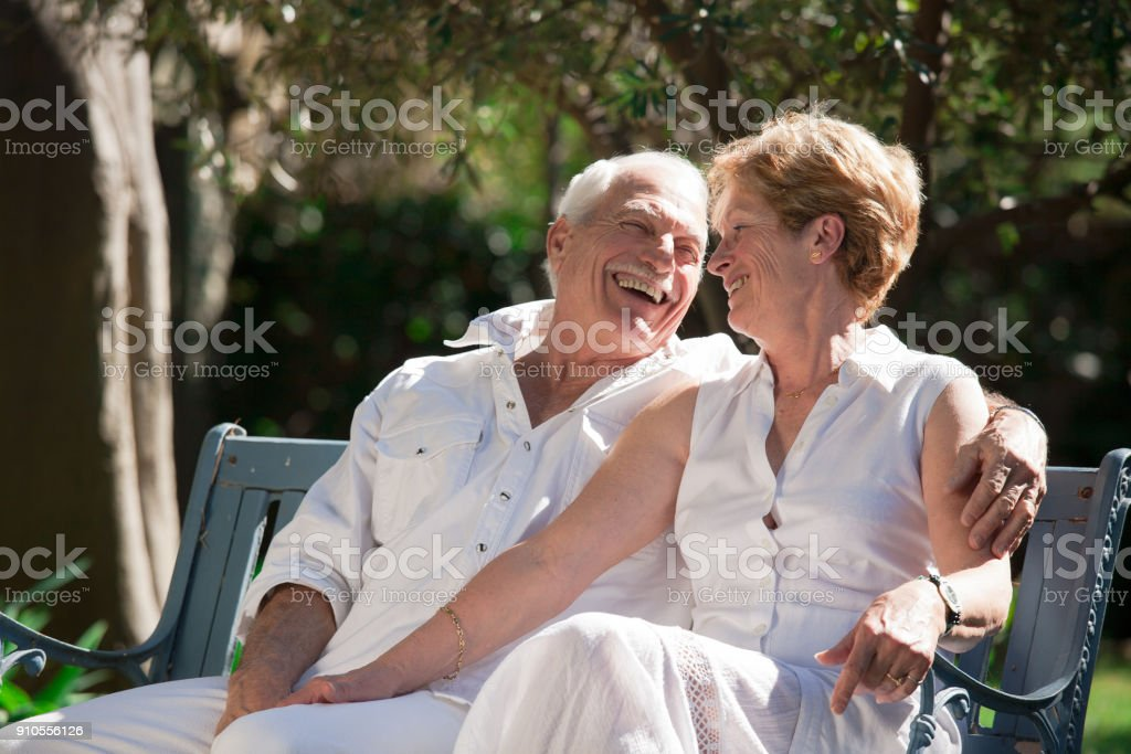 senior couple in a garden in the spring стоковое фото