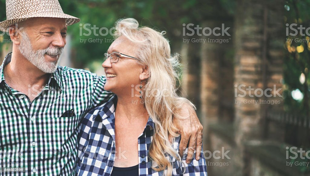 Senior couple in a relaxing walk. stock photo