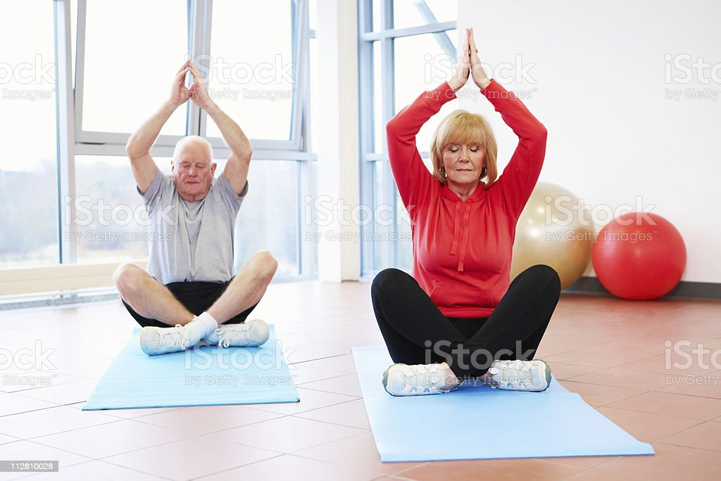 Senior Couple in a Yoga Pose - Royalty-free 50-59 Years Stock Photo