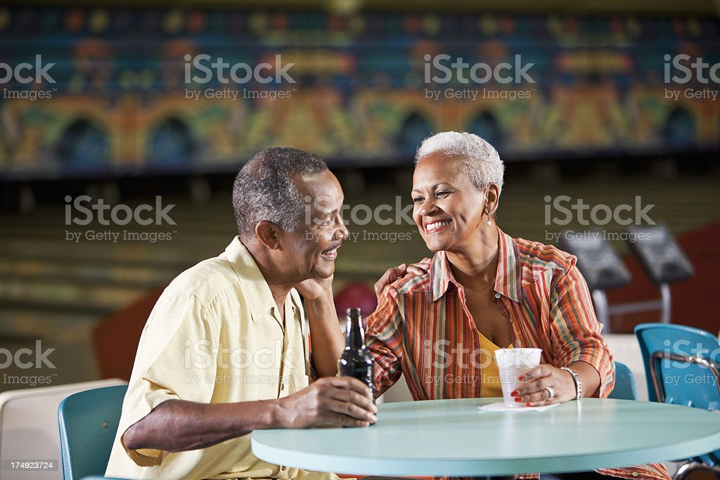 Senior couple in bowling alley royalty-free stock photo