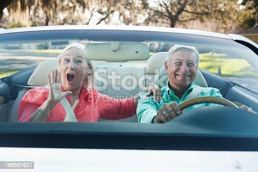 108329737 istock photo Senior couple in convertible 186581621