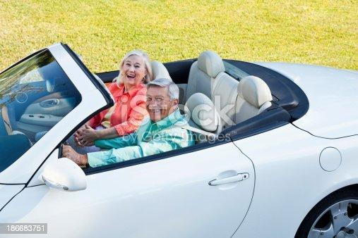 108329737 istock photo Senior couple in convertible 186683751