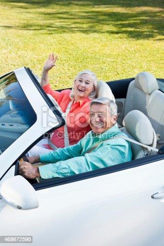 108329737 istock photo Senior couple in convertible 468672595