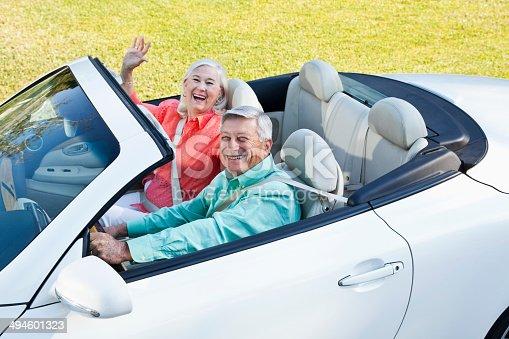 108329737 istock photo Senior couple in convertible 494601323