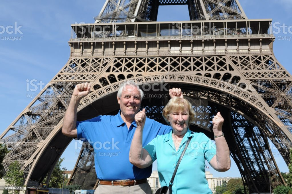Senior couple in front of Eiffel Tower royalty-free stock photo