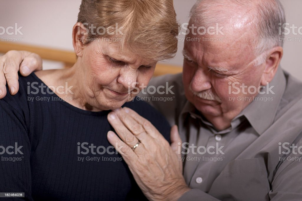 Senior couple in grief (DEPRSSION SERIES) stock photo