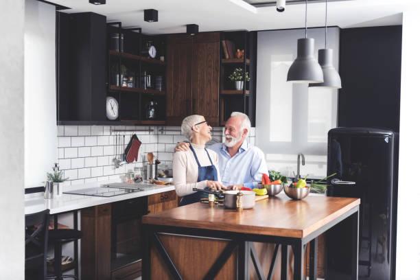 Senior couple in kitchen stock photo