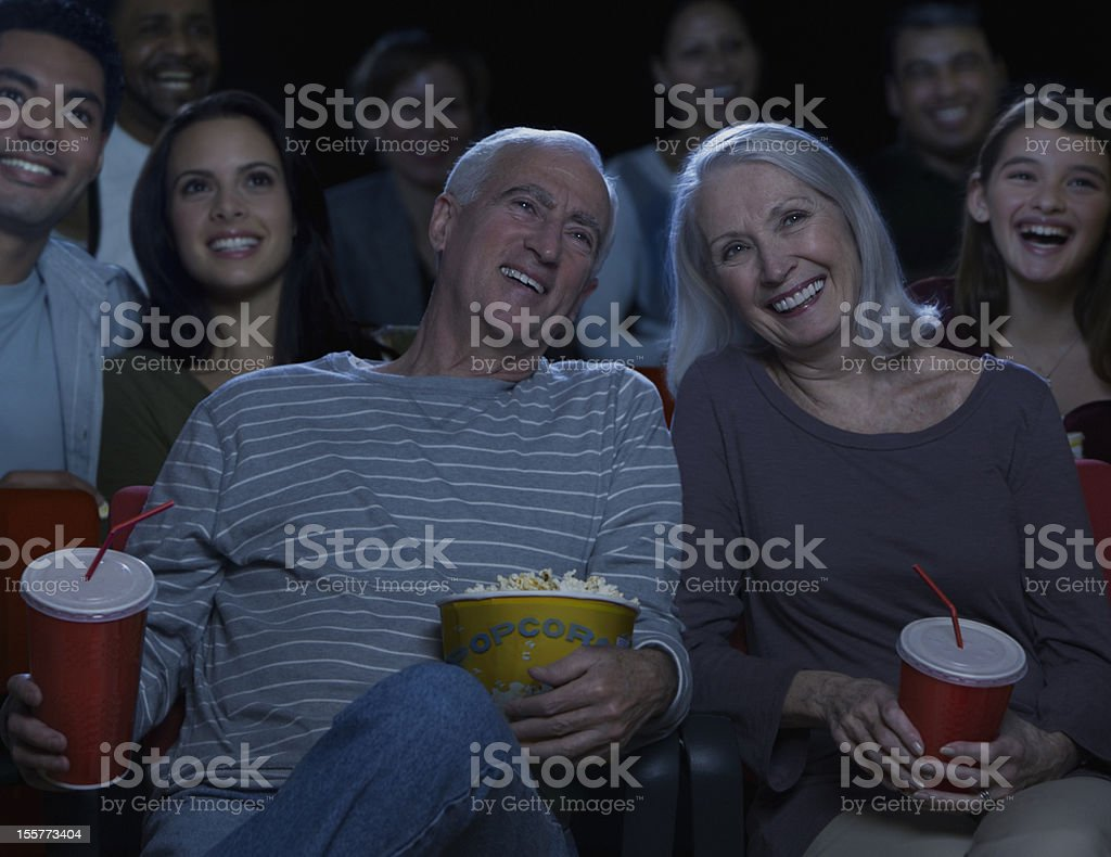 Senior couple in movie theater stock photo
