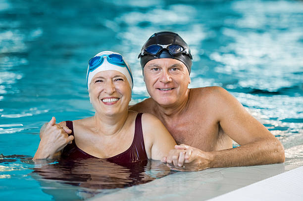 Senior couple in pool - Photo