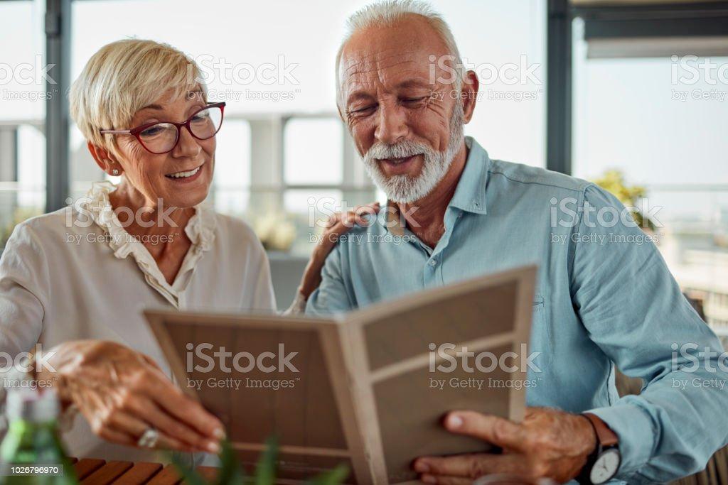 Senior Couple In Restaurant Ordering Food stock photo