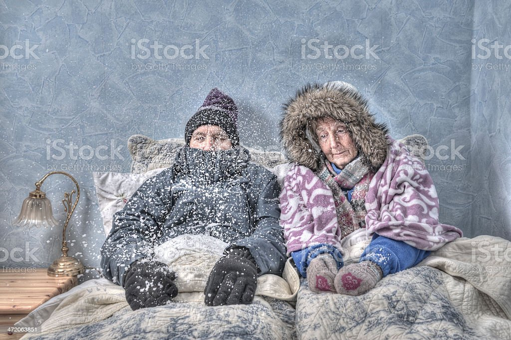 Senior couple in snow-covered bed stock photo