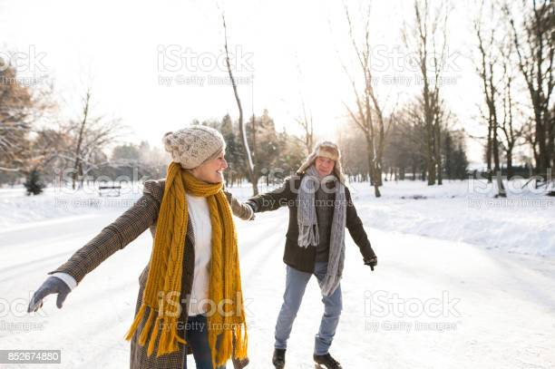 Senior couple in sunny winter nature ice skating picture id852674880?b=1&k=6&m=852674880&s=612x612&h=cus8ewd3lwsvvpfr gn dxees4llc8g4lnya ycpzus=