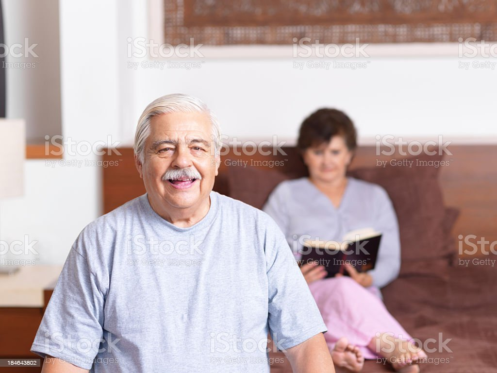 Senior couple in the bedroom royalty-free stock photo
