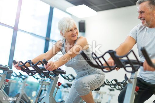 istock Senior Couple in the Gym 624854322