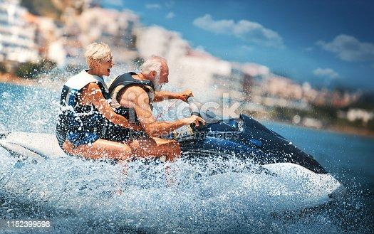 istock Senior couple jet skiing. 1152399598