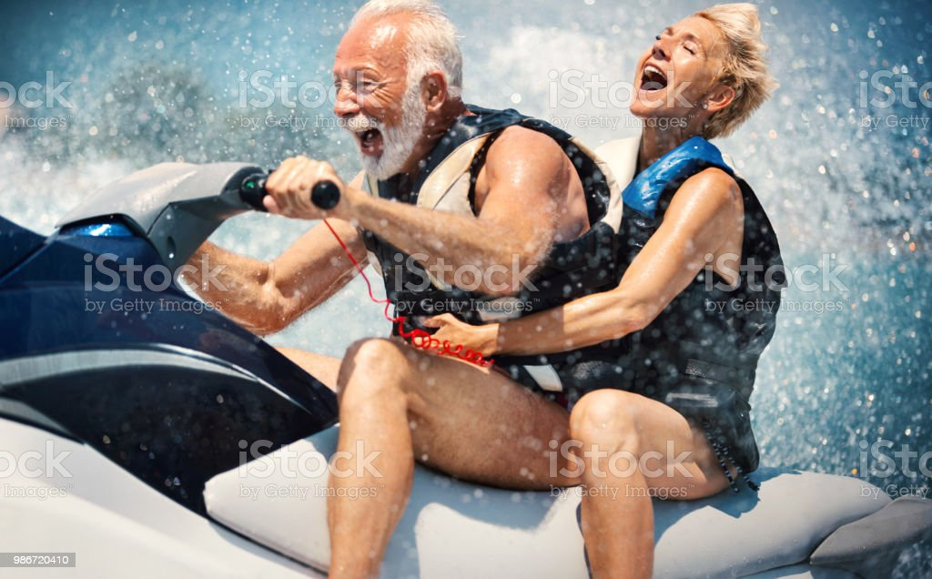 Senior couple jet skiing. stock photo