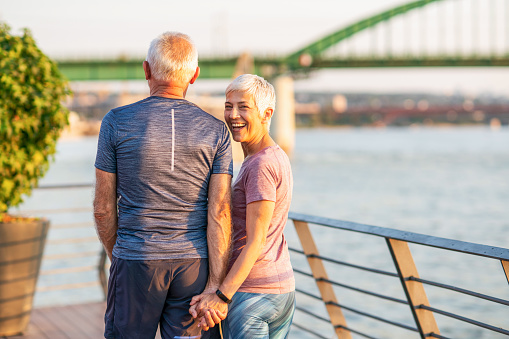 Senior couple jogging by the river