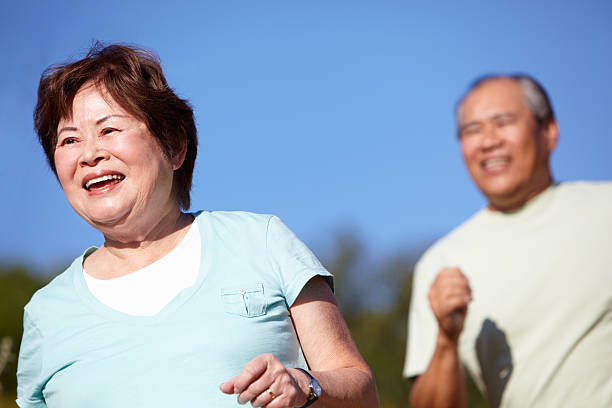 Senior couple jogging stock photo