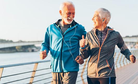 Senior couple jogging together