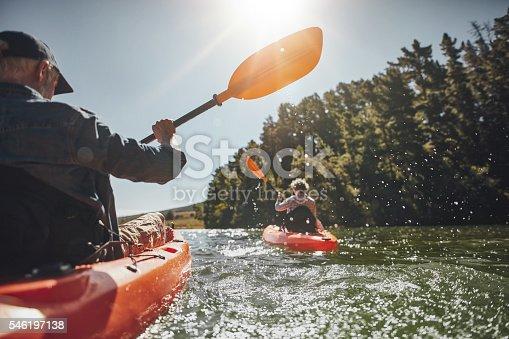 istock Senior couple kayaking in a lake 546197138