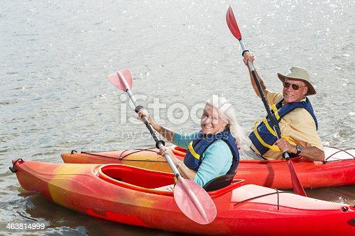 istock Senior couple kayaking 463814999