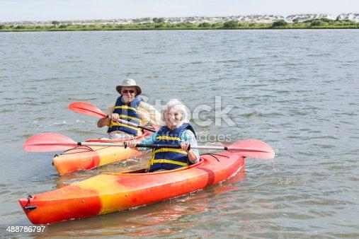 istock Senior couple kayaking together on Intracoastal waterway 488786797