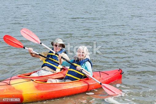 istock Senior couple kayaking together 472190363